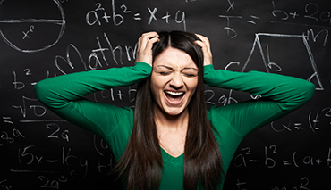 Stressed woman screaming near the blackboard with difficult task